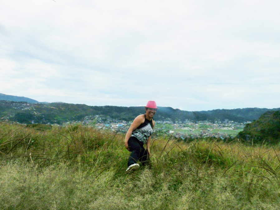 Adventure lady on top of La Trinidad Valley